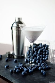 Blueberry Cheesecake Martini - ◾5 ounces vanilla vodka ◾2 ounces heavy cream ◾1 ounce coffee liqueur ◾1/2 ounce strawberry liqueur ◾2 tablespoons blueberry preserves or jelly ◾fresh blueberries for garnish (optional)