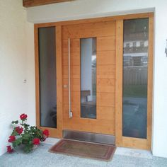Porte anteriori in legno House Entrance, Entrance Doors, Wooden Carports, New Kitchen Doors, Wood Front Doors, Prefabricated Houses, High Walls, Timber House, Living Furniture