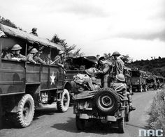 1st Armoured Division - exercises before the invasion of the continent (14/17 July 1944.). Transport column of a division infantry. Visible Bedford trucks and SUV 4x4 Jeep.