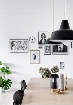 Paintings, photographs and hanging candlestick kept in the same colour scheme creates an interesting gallery wall with a calm feeling.