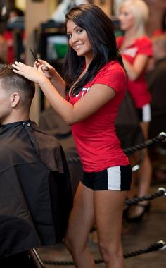saloncapes.com crepe hair cutting cape in a Knockouts ad.