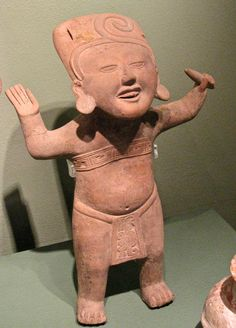 Pre-Columbian America : Mixtecs: A jolly figure at Puebla's Museo Amparo. The figure is one of many similar smiling statues found in ancient Mixtec graves in Oaxaca's Monte Alban and Mitla. Apparently, laughing it up and having a good old time was one way to get the gods on your side. Mexican Colors, Ancient Artefacts, Ugly Dolls, Mesoamerican, North And South America, Mexican Folk Art, Native Art, Ancient History, Carlos Castaneda