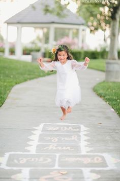 A Game of Hopscotch for Your Flower Girl / onelove photography / At Your Door Events / via StyleUnveiled.com / see more http://styleunveiled.com/wedding-blog/the-style-unveiled-cutting-room-floor-is-so-pretty.html