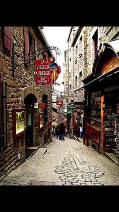 Shopping at Mont Saint Michel, Manche, Normandie, France. Places Around The World, Travel Around The World, Around The Worlds, Places To Travel, Places To See, Wonderful Places, Beautiful Places, Le Mont St Michel, Belle France