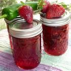 """Jalapeno Strawberry Jam recipe.  """"This is a favorite at Christmas. This jam is not spicy, but can be made to be spicy by adding more peppers or a few habanero peppers. The flavor of the sweet strawberries combined with the flavor of the peppers gives this jam a wonderful flavor dimension. The strawberries may be frozen (thawed and crushed) and the peppers may be canned (drained and chopped)."""