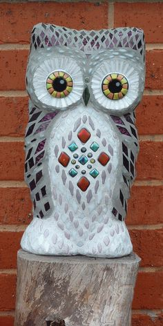 This mosaic sculture features a lovely owl, by lucyc70
