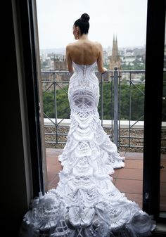 Nightmare -- This lace wedding dress by J'aton Couture is a monstrosity.  It makes her butt look so weird!  And the train looks like a peacock.  Yuck.