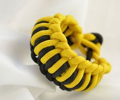 The quick deploy paracord bracelet is one of the most beautiful bracelets I made so far. Although it is made because of the fact that it is easy to disassemble and use as cord, I have made it because I like the bumblebee motive that the combination of yellow and black make. This is one of the bracelets that I feature in my new book on paracord bracelets.The bracelet is essentially made from two pieces of cord. After setting it up by making a basic slip knot on each of the cords we simply…