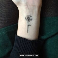 http://www.tattoovault.com/uploads/content/sunflower-tattoo-idea-on-hand.jpg