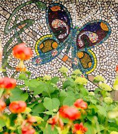 Backyards we love: A Door County, Wisconsin, gardener dresses up a garage with decorative mosaic panels. More photos from this garden: http://www.midwestliving.com/garden/featured-gardens/garden-tour-door-county-mosaic-art/