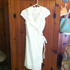 Calypso white wrap dress Calypso white wrap dress size small Dresses