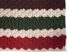 Rows of crocodile stitch sections give this crochet blanket pattern some extra warmth