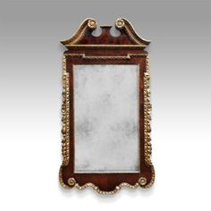 Rare and Impressive George II walnut and parcel gilt pier mirror