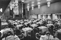 The First Class Salle a Manger (Dining Room) on board the refurbished, post-War Ile de France (1949), restored as the flagship of the Compagnie Générale Transatlantique, more commonly known to English-language passengers as The French Line.  Image from the Private Collection of John Cunard-Shutter.