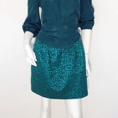 22204a42fc Size 12 metallic jade green and black a-line skirt with pockets. Mid thigh