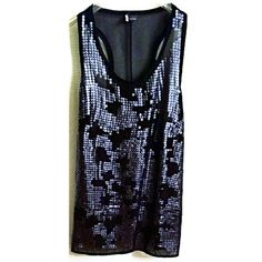 Black Hi-Lo Sheer Sequin Hi Low Black Sheer Racerback Flowy Tank with front metallic sequins  Material: 100% Polyester.  Style: Racerback and Flowy Color: Black with metallic sequins  Size: Medium  Preowned. I don't remember wearing it, so if worn; no more than 1 time. Sparkle & Fade Tops