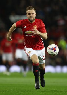 Luke Shaw of Manchester United runs with the ball during the EFL Cup Fourth Round match between Manchester United and Manchester City at Old Trafford on October 26, 2016 in Manchester, England.