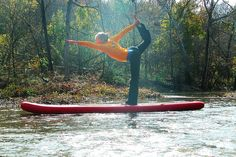 paddle board yoga!..i would be in the water most of the time...but looks fun