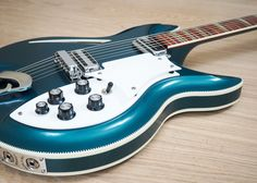 Even when turquoise was later available as a custom color option, it was never available on the 381V69 outside of this instrument! With a prominent German Carve top and back highlighted by checkerboard binding and a custom color finish, few guitars can match the elegant visual appeal of the 381.   eBay!