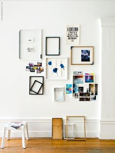 beautiful gallery walls. especially love the idea of hanging an empty frame then pinning pictures into it on the wall