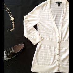 """White House Black Market White Cardigan XS This WHBM cardigan is lightweight and perfect for Spring & Summer with 3/4 length sleeves. It is fitted at the waist and accented with silver buttons. The top has been gently worn. It measures 16"""" across the bust. White House Black Market Tops"""