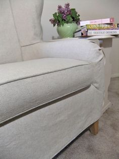 Linen welt cord trims this cotton and linen basketweave slipcover.