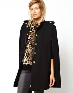 Coat by MangoMade from a soft wool blendFunnel necklinePress stud placket through frontCape-style sleevesLeather-look trimRelaxed fitABOUT MANGOCombining timeless style with fashion forward designs, Barcelona-born Mango are renowned for bringing their European touch to statement dresses and tailored garments. Simple lines and minimalist silhouettes feature prominently throughout their collections, which include tailored jackets, classic eveningwear and a covetable denim line. Please note…