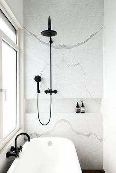 HGTV's Genevieve Gorder's favorite home decor and interior design picks for 2016 - on the Dog Lady Design Files blog! One of her favorites? Matte black fixtures. This beautiful matte black showerhead and faucet in a white calcatta marble bathroom - swoonworthy! Interior Design, Home Decorating and Dog Musings from Jersey City www.dogladydesignfiles.com