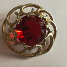 Round Red Glass with Decorative Gold Tone Rim Brooch Brooch Dimensions +/- . 27 x 27 (mm) : x (inch) Brooch Weight +/- . 6 g : ounces Red Glass, Heart Ring, Arts And Crafts, Brooch, Jewellery, Rings, Gold, Decor, Jewels