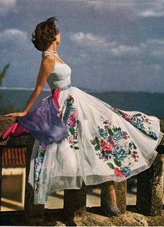 If I could live this life, I totally would. Dress, ocean, relaxed pose and all. :: Vintage 1940s fashion from Vogue. Photographer unknown.