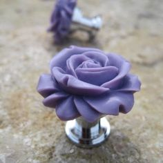 These cute little purple rose drawer knobs will look great in a little girls room.