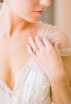 Brides.com: . A blushing bride daintily poses with her dazzling diamond ring.