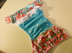 How to make a patchwork style ruffled one-size pocket diaper from quilting scraps