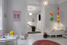 White room with little colourful blobs