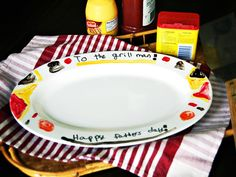 Hand-Painted Father's Day Grill Platter    Surprise the grill king in your home with a hand-painted ceramic platter that's a fun and easy project for kids, Dad will be proud to serve perfectly cooked burgers on this custom Father's Day gift.