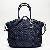 Quilted Coach bag; I currently own one black and one white quilted Coach purse but the classic logo is quilted into the purse unlike this one that is just a plain quilt print. I would love to have this navy chevron version as well :)