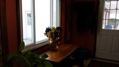 Not the best picture, but the kitchen entry also has a large window overlooking the patio and park.