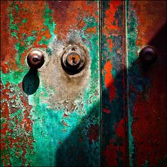 rust, paint, and shadows    just shows, the ageing process can be colourful....? !   what's behind the door  ???????