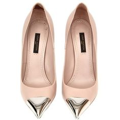 "Louis Vuitton ""Allamanda"" pumps in make-up leather with an silver-tone toe cap. Have been worn and are in excellent condition."