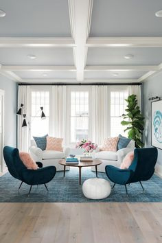 Four plush chairs take center stage in the newly-remodeled living room at HGTV Urban Oasis 2017 highlighting the architecture of this Craftsman layout with historical inspiration. - July 06 2019 at Coastal Living Rooms, Chic Living Room, New Living Room, Living Room Interior, Living Room Furniture, Living Room Decor, Living Spaces, Blue And Pink Living Room, Urban Furniture