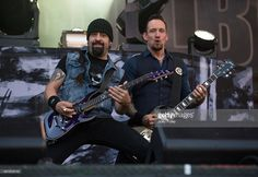 Rob Caggiano and Michael Poulsen of Volbeat performs live onstage during the 2014 Louder Than Life Festival at Champions Park on October 5, 2014 in Louisville, Kentucky.