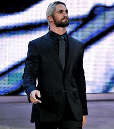 Seth Rollins is going to the ring he does look good in a suit