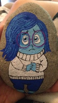 Sadness painted on a rock disney