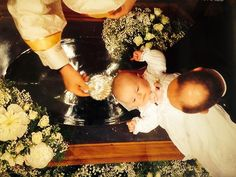 Prince Albert II of Monaco holds his daughter, Princess Gabriella of Monaco, as she is baptized on 10 May 2015