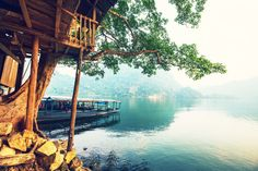 Tranquil waters at Ba Be National Park. Activities such as hiking and kayaking. Home to 13 ethnic minority villages and small fishing villages. Homestay programs allow travelers to stay in traditional stilted houses.