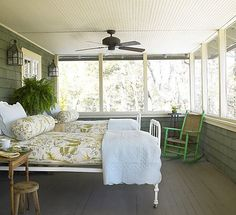 Old fashioned summer sleeping porch to catch refreshing night breezes.