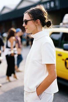 Le Fashion Blog NYC Street Style White On White Low Bun Chignon Mock Neck Top Boyfriend Jeans Via Vanessa Jackman photo Le-Fashion-Blog-NYC-Street-Style-White-On-White-Low-Bun-Chignon-Mock-Neck-Top-Boyfriend-Jeans-Via-Vanessa-Jackman.jpg