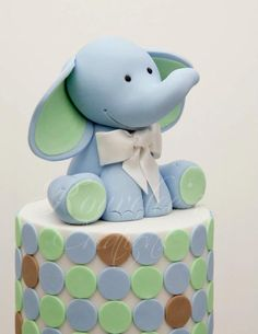 A better version of our old elephant design. I love him so much, I didn't want to part with him :( Medium: Modelling Fondant Photo Credit: Arnaldo Ilagan Photography Fondant Toppers, Fondant Cakes, Cupcake Cakes, Sweets Cake, Fancy Cakes, Cute Cakes, Cupcakes Decorados, Elephant Cakes, Fondant Animals