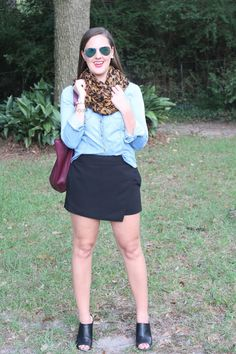 Leopard scarf, chambray shirt, skort, and black mules via With Style and a Little Grace