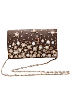 Shimmer, sparkle and lots of gloss is what you get with this striking Kaleido clutch. Mirror and zardosi embroidery lend this clutch its sparkly accents. Its subdued raw silk backing material sets off the embroidery beautifully. Equipped with an interior wall slip pocket, this clutch is lined with soft velvet suede inside. Sling it on with the detachable silver chain or clutch it to add lots of gloss to your festive look!